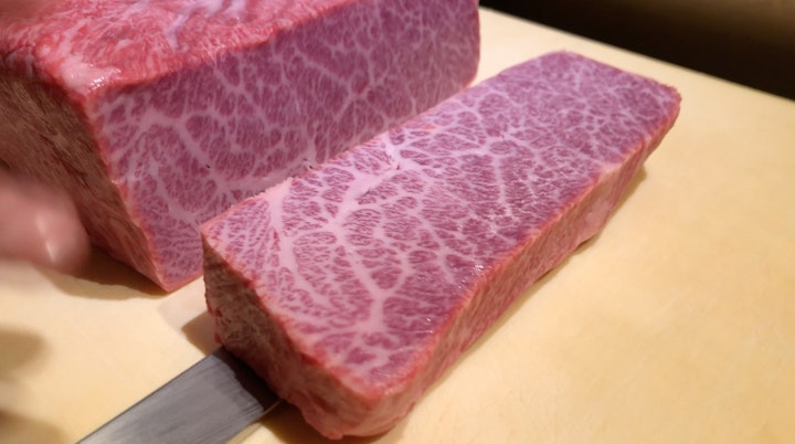 Slicing through the Hida-gyu A5 Wagyu
