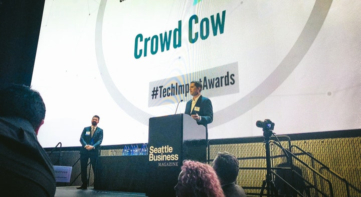 Crowd Cow's Joe Heitzeberg accepting a Tech Impact Award 2018