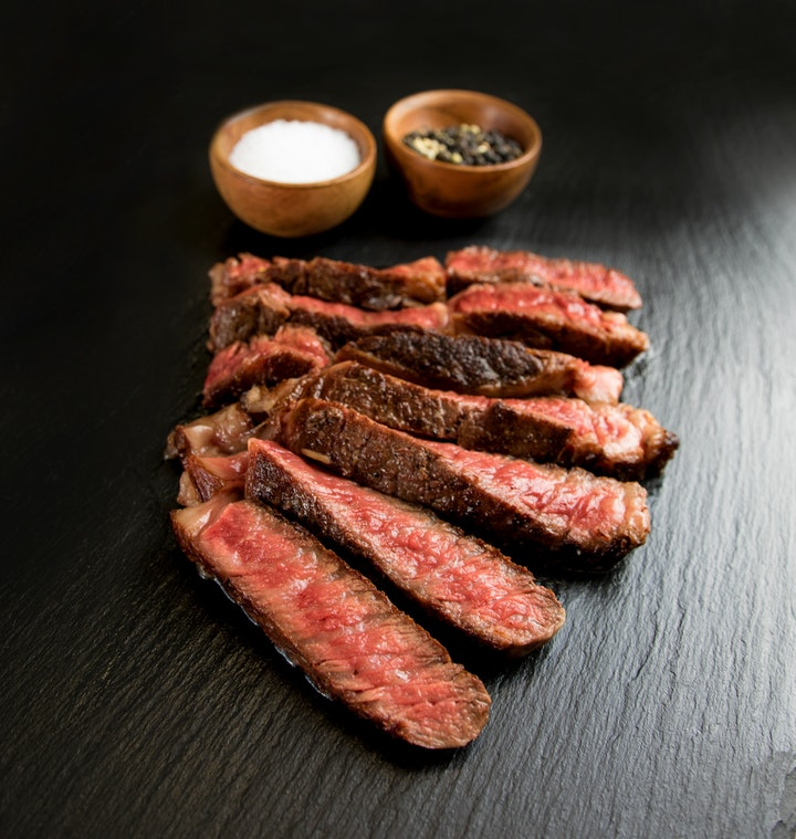 Cooked steak with salt and pepper for garnish