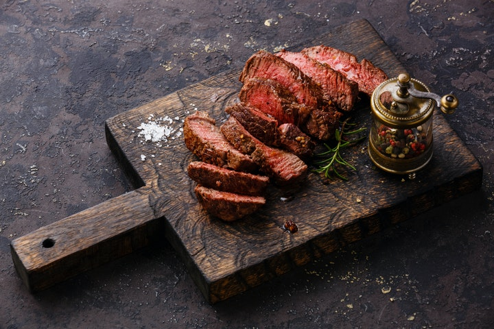 Delicious steak cut on a board