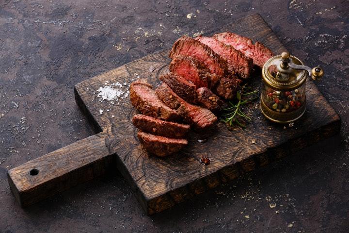Delicious steak cut on a board